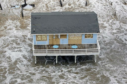<div class='meta'><div class='origin-logo' data-origin='none'></div><span class='caption-text' data-credit='AP Photo/ David J. Phillip'>In this photo taken Sept. 12, 2008, a boarded up home sits along the beach as Hurricane Ike approaches Galveston, Texas.</span></div>