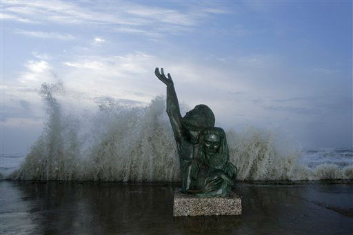<div class='meta'><div class='origin-logo' data-origin='none'></div><span class='caption-text' data-credit='AP Photo/ Matt Slocum'>Waves crash behind a statue commemorating the devastating storm of 1900 as Hurricane Ike approaches, Friday, Sept. 12, 2008, in Galveston, Texas.</span></div>