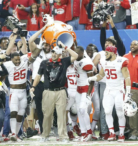 <div class='meta'><div class='origin-logo' data-origin='none'></div><span class='caption-text' data-credit='AP Photo/ John Bazemore'>Houston head coach Tom Herman is doused with sports drink during the second half of the Peach Bowl</span></div>