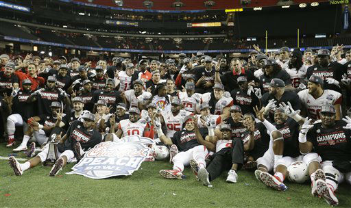 <div class='meta'><div class='origin-logo' data-origin='none'></div><span class='caption-text' data-credit='AP Photo/ David Goldman'>Houston football players pose for a photo after the Peach Bowl NCAA college football game against Florida State</span></div>