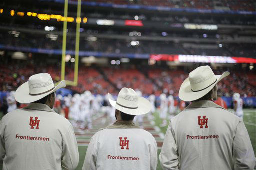 <div class='meta'><div class='origin-logo' data-origin='none'></div><span class='caption-text' data-credit='AP Photo/ David Goldman'>Houston spirit team members watch the team warm up before the first half of the Peach Bowl</span></div>