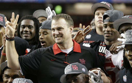 <div class='meta'><div class='origin-logo' data-origin='none'></div><span class='caption-text' data-credit='AP Photo/ David Goldman'>Houston head coach Tom Herman celebrates after the Peach Bowl</span></div>