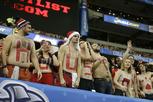 <div class='meta'><div class='origin-logo' data-origin='none'></div><span class='caption-text' data-credit='AP Photo/ David Goldman'>Houston fans cheer against Florida State during the first half of the Peach Bowl</span></div>