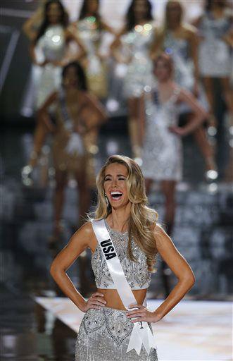 "<div class=""meta image-caption""><div class=""origin-logo origin-image none""><span>none</span></div><span class=""caption-text"">Miss USA Olivia Jordan reacts after making the final 15 at the Miss Universe pageant Sunday, Dec. 20, 2015, in Las Vegas.   (AP Photo/ John Locher)</span></div>"