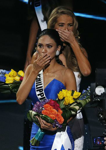 """<div class=""""meta image-caption""""><div class=""""origin-logo origin-image none""""><span>none</span></div><span class=""""caption-text"""">Miss Philippines Pia Alonzo Wurtzbach, front, reacts after she was announced as the new Miss Universe  (AP Photo/ John Locher)</span></div>"""