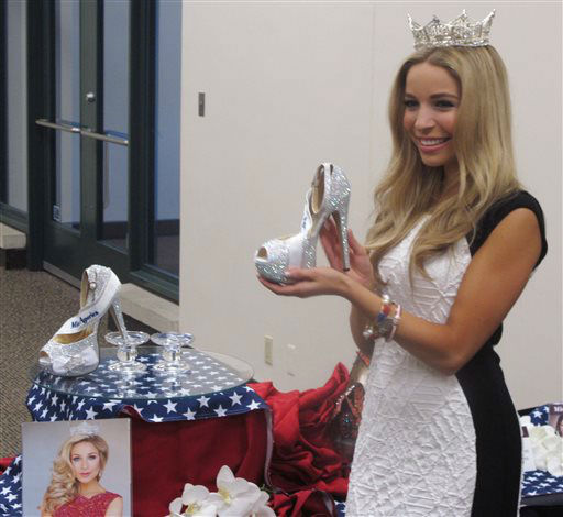 "<div class=""meta image-caption""><div class=""origin-logo origin-image none""><span>none</span></div><span class=""caption-text"">Miss America Kira Kazantsev holds the shoes she will wear in this week's ""Show Us Your Shoes"" parade on the Atlantic City, N.J. (AP Photo/ Wayne Parry)</span></div>"