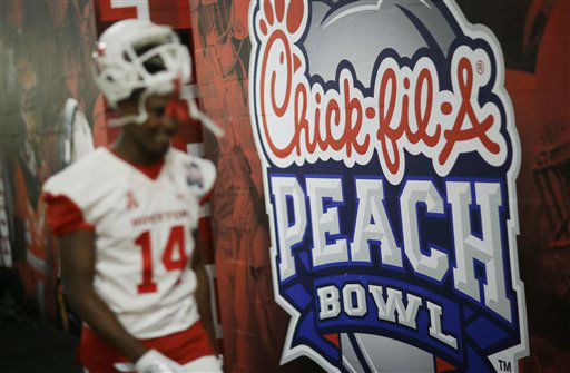 <div class='meta'><div class='origin-logo' data-origin='none'></div><span class='caption-text' data-credit='AP Photo/ David Goldman'>Houston wide receiver Isaiah Johnson walks to the locker room before the first half of the Peach Bowl</span></div>