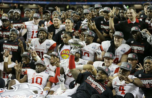 <div class='meta'><div class='origin-logo' data-origin='none'></div><span class='caption-text' data-credit='AP Photo/ David Goldman'>The Houston team celebrates with the Peach Bowl trophy after the Peach Bowl</span></div>