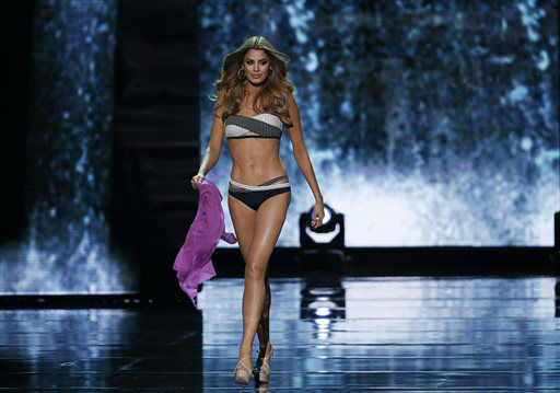 """<div class=""""meta image-caption""""><div class=""""origin-logo origin-image none""""><span>none</span></div><span class=""""caption-text"""">Miss Colombia Ariadna Gutierrez competes in the swimsuit competition at the Miss Universe pageant  (AP Photo/ John Locher)</span></div>"""