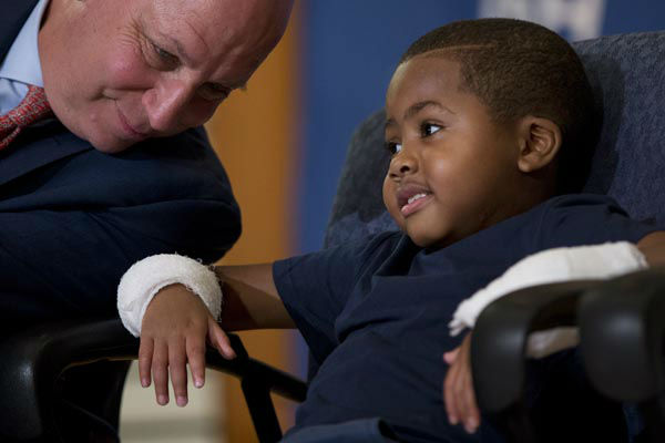 <div class='meta'><div class='origin-logo' data-origin='none'></div><span class='caption-text' data-credit='AP Photo/ Matt Rourke'>As Dr. L. Scott Levin holds speaks with double-hand transplant recipient eight-year-old Zion Harvey during a news conference Tuesday, July 28, 2015</span></div>