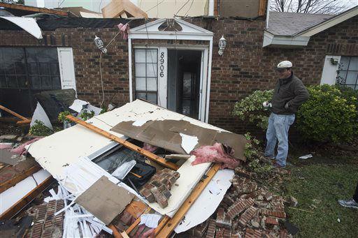 "<div class=""meta image-caption""><div class=""origin-logo origin-image none""><span>none</span></div><span class=""caption-text"">Michael Downard stands outside his house in Rowlett, Texas, Sunday, Dec. 27, 2015  (AP Photo/ Rex C. Curry)</span></div>"