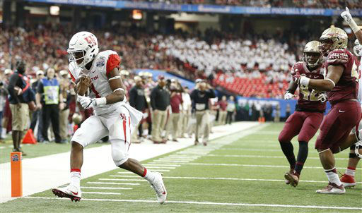 <div class='meta'><div class='origin-logo' data-origin='none'></div><span class='caption-text' data-credit='AP Photo/ John Bazemore'>Houston quarterback Greg Ward Jr. (1) runs into the end zone for a touchdown against Florida State</span></div>