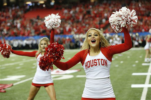 <div class='meta'><div class='origin-logo' data-origin='none'></div><span class='caption-text' data-credit='AP Photo/ John Bazemore'>Houston cheerleaders perform before the first half of the Peach Bowl</span></div>