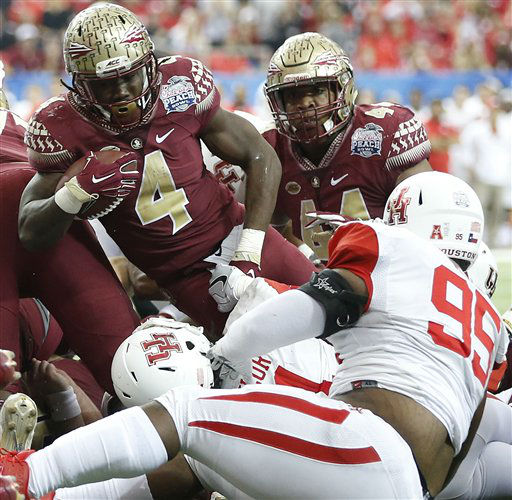 <div class='meta'><div class='origin-logo' data-origin='none'></div><span class='caption-text' data-credit='AP Photo/ John Bazemore'>Florida State running back Dalvin Cook (4) runs into the end zone for a touchdown against Houston</span></div>