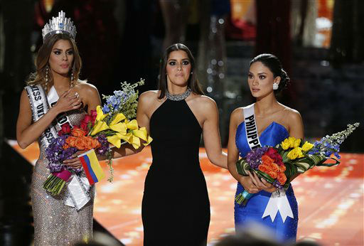 """<div class=""""meta image-caption""""><div class=""""origin-logo origin-image none""""><span>none</span></div><span class=""""caption-text"""">Former Miss Universe Paulina Vega, center, reacts before taking away the flowers, crown and sash from Miss Colombia Ariadna Gutierrez  (AP Photo/ John Locher)</span></div>"""