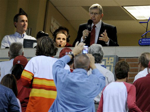 <div class='meta'><div class='origin-logo' data-origin='none'></div><span class='caption-text' data-credit='AP Photo/ Pat Sullivan'>Houston Astros broadcaster Milo Hamilton thanks his fans during the seventh inning stretch of a baseball game against the St. Louis Cardinals</span></div>