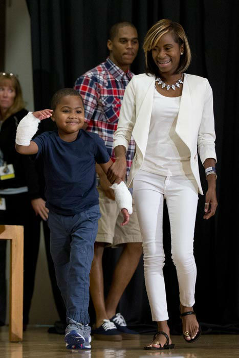 <div class='meta'><div class='origin-logo' data-origin='none'></div><span class='caption-text' data-credit='AP Photo/ Matt Rourke'>Double-hand transplant recipient eight-year-old Zion Harvey arrives to a news conference with his mother Pattie Ray Tuesday, July 28, 2015</span></div>