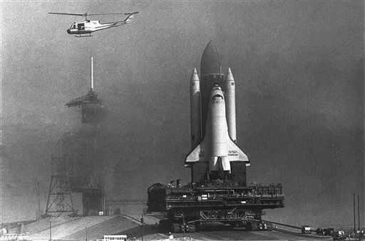 <div class='meta'><div class='origin-logo' data-origin='none'></div><span class='caption-text' data-credit='AP Photo/ Ron Lindsey'>The Space Shuttle Challenger heads into a fog bank as it rolls towards pad 39-A</span></div>