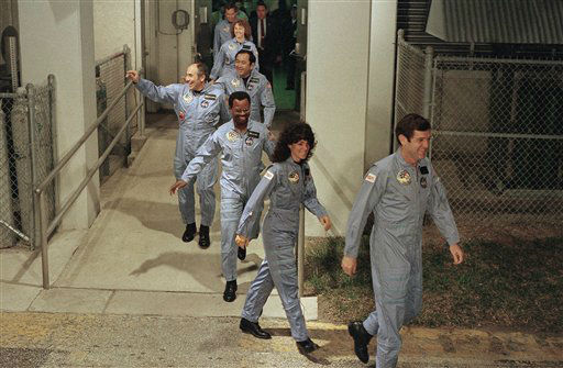 <div class='meta'><div class='origin-logo' data-origin='none'></div><span class='caption-text' data-credit='AP Photo/ Steve Helber'>The crew for the Space Shuttle Challenger flight 51-L leaves their quarters for the launch pad</span></div>