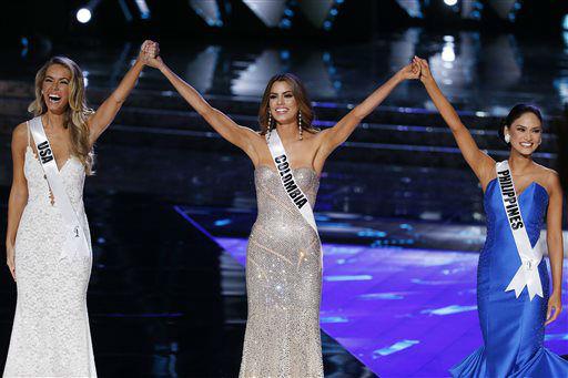 "<div class=""meta image-caption""><div class=""origin-logo origin-image none""><span>none</span></div><span class=""caption-text"">From left, Miss USA Olivia Jordan, Miss Colombia Ariadna Gutierrez and Miss Philippines Pia Alonzo Wurtzbach react as they make the final three   (AP Photo/ John Locher)</span></div>"