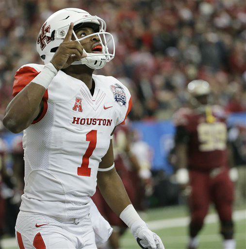 <div class='meta'><div class='origin-logo' data-origin='none'></div><span class='caption-text' data-credit='AP Photo/ David Goldman'>Houston quarterback Greg Ward Jr. (1) celebrates his touchdown against Florida State</span></div>