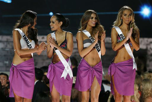 "<div class=""meta image-caption""><div class=""origin-logo origin-image none""><span>none</span></div><span class=""caption-text"">From left, Miss Thailand Aniporn Chalermburanawong, Miss Japan Ariana Miyamoto, Miss Colombia Ariadna Gutierrez and Miss USA Olivia Jordan   (AP Photo/ John Locher)</span></div>"