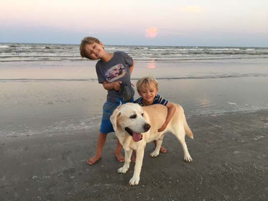 "<div class=""meta image-caption""><div class=""origin-logo origin-image none""><span>none</span></div><span class=""caption-text"">Ilona's sons with their dog, Aspen</span></div>"