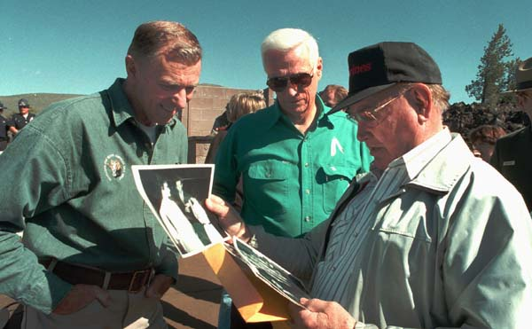 <div class='meta'><div class='origin-logo' data-origin='AP'></div><span class='caption-text' data-credit='ASSOCIATED PRESS'>Former NASA astronauts Joe Engle, left, and Gene Cernan, center, look over a collection of 30-year-old photographs.(AP Photo/Bill Schaefer)</span></div>