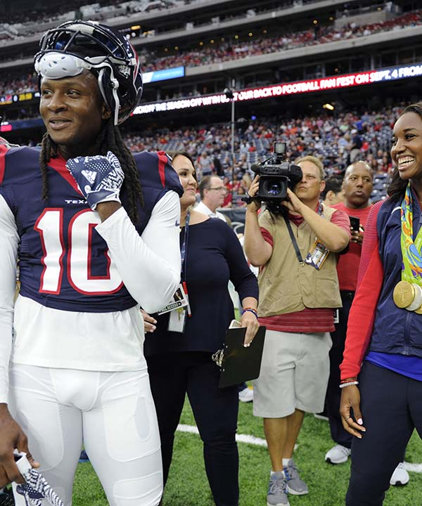 """<div class=""""meta image-caption""""><div class=""""origin-logo origin-image none""""><span>none</span></div><span class=""""caption-text"""">Olympic gold medalist Simone Manuel, right, visits with Houston Texans wide receiver DeAndre Hopkins, left, prior to an NFL preseason football game (AP Photo/Eric Christian Smith) (AP)</span></div>"""