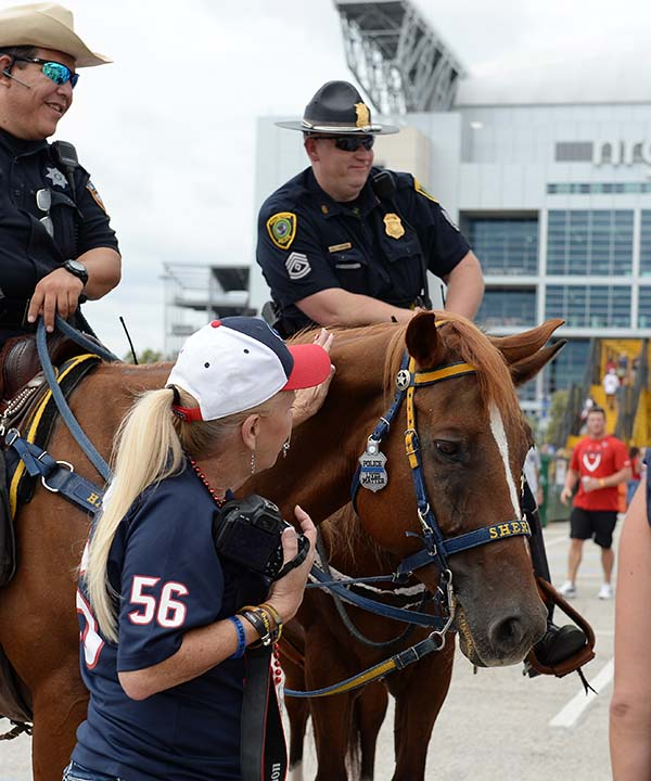 """<div class=""""meta image-caption""""><div class=""""origin-logo origin-image none""""><span>none</span></div><span class=""""caption-text"""">Law enforcement use horses to patrol outside at NRG Stadium prior to an NFL preseason football game between the Houston Texans and the Arizona Cardinals (AP Photo/George Bridges) (AP)</span></div>"""