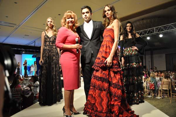 <div class='meta'><div class='origin-logo' data-origin='none'></div><span class='caption-text' data-credit='Guests at Latin Women's Initiative's Fashion Show & Luncheon'></span></div>