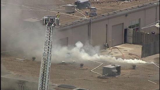<div class='meta'><div class='origin-logo' data-origin='KTRK'></div><span class='caption-text' data-credit=''>Firefighters battle a four-alarm fire in southwest Houston.</span></div>
