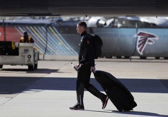 <div class='meta'><div class='origin-logo' data-origin='AP'></div><span class='caption-text' data-credit='AP'>Atlanta Falcons' Matt Ryan walks to the bus as the team arrives at George Bush Intercontinental Airport for the NFL Super Bowl 51. (AP Photo/Eric Gay)</span></div>