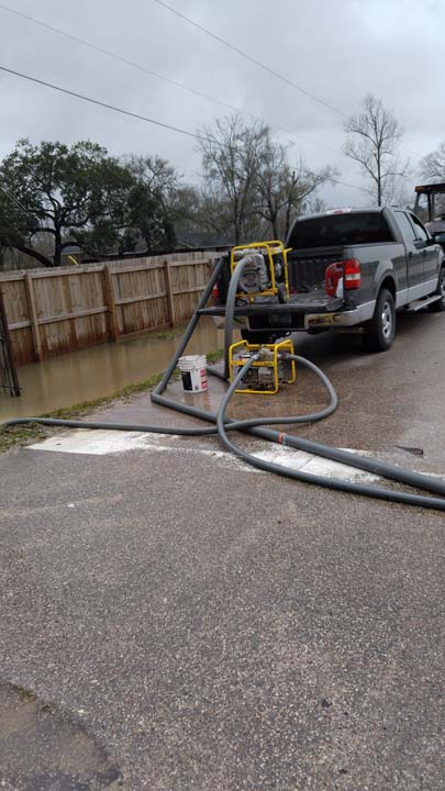<div class='meta'><div class='origin-logo' data-origin='none'></div><span class='caption-text' data-credit=''>ABC13 Investigative Reporter, Ted Oberg gets help for neighbors who blame flooding on road construction</span></div>
