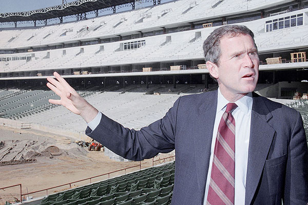 <div class='meta'><div class='origin-logo' data-origin='AP'></div><span class='caption-text' data-credit='Ron Heflin'>George W. Bush, as part owner of the Texas Rangers, points out some of the amenities Nov. 7, 1993 during construction of the Ballpark in Arlington, Texas.</span></div>
