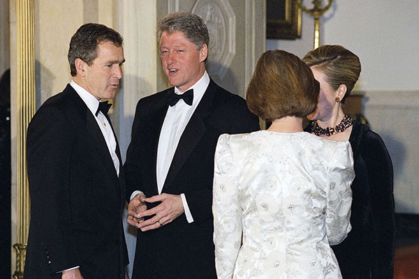 <div class='meta'><div class='origin-logo' data-origin='AP'></div><span class='caption-text' data-credit='Greg Gibson'>Then-Gov. George W. Bush meets with then-Pres. Bill Clinton at the White House during a state dinner on Jan. 29, 1995.</span></div>