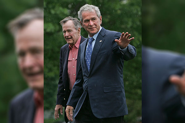 <div class='meta'><div class='origin-logo' data-origin='AP'></div><span class='caption-text' data-credit='Lawrence Jackson'>President Bush and his father, former President George H. W. Bush, arrive on the South Lawn of White House in Washington, Sunday, May 11, 2008.</span></div>