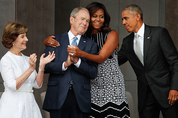 <div class='meta'><div class='origin-logo' data-origin='AP'></div><span class='caption-text' data-credit='Pablo Martinez Monsivais'>First lady Michelle Obama hugs former President George W. Bush, as President Barack Obama and former first lady Laura Bush walk on stage on Sept. 24, 2016.</span></div>