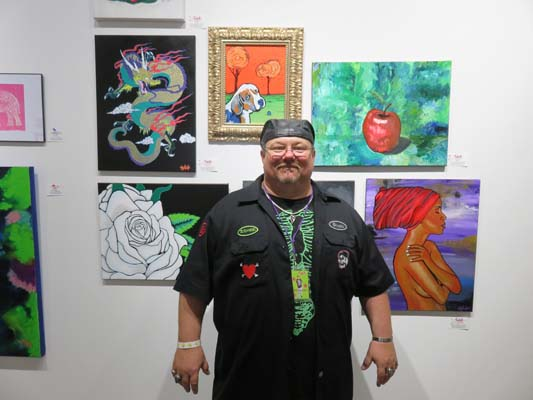 "<div class=""meta image-caption""><div class=""origin-logo origin-image none""><span>none</span></div><span class=""caption-text"">Artist Panisch at Chocolate & Art Show in Houston</span></div>"