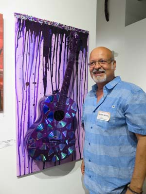 "<div class=""meta image-caption""><div class=""origin-logo origin-image none""><span>none</span></div><span class=""caption-text"">Artist Orlando Reyna at Chocolate & Art Show in Houston</span></div>"