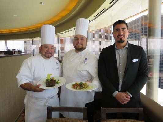 <div class='meta'><div class='origin-logo' data-origin='none'></div><span class='caption-text' data-credit=''>Restaurant Manager Ricardo Salcedo with Chefs</span></div>