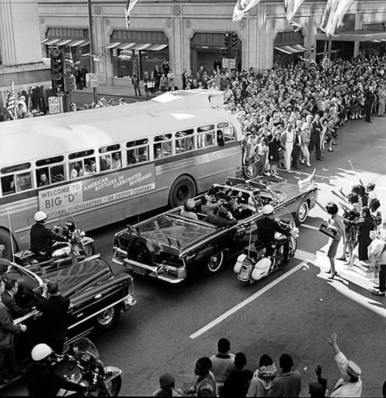 "<div class=""meta image-caption""><div class=""origin-logo origin-image none""><span>none</span></div><span class=""caption-text"">U.S. President John F. Kennedy and first lady Jacqueline Kennedy are riding in the backseat of an open limousine as the presidential motorcade approaches Dealey Plaza in Dallas (AP Photo/XCB)</span></div>"
