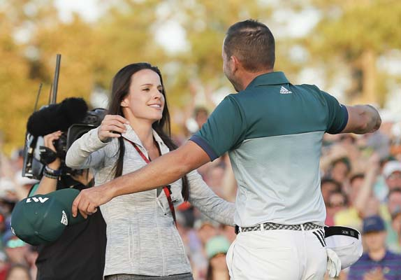 "<div class=""meta image-caption""><div class=""origin-logo origin-image ap""><span>AP</span></div><span class=""caption-text"">Sergio Garcia, of Spain, reacts with his fiancee Angela Atkins after making his birdie putt on the 18th green to win the Masters golf tournament.(AP Photo/David J. Phillip) (AP)</span></div>"