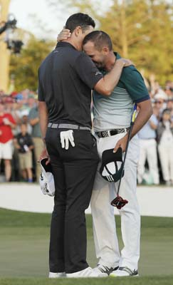 "<div class=""meta image-caption""><div class=""origin-logo origin-image ap""><span>AP</span></div><span class=""caption-text"">Sergio Garcia, of Spain, hugs Justin Rose, of England, after making his birdie putt on the 18th green to win the Masters golf tournament. (AP Photo/David J. Phillip) (AP)</span></div>"