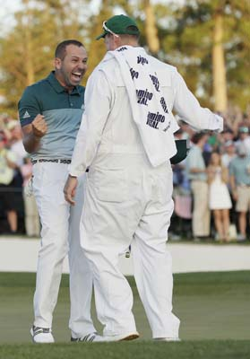 "<div class=""meta image-caption""><div class=""origin-logo origin-image ap""><span>AP</span></div><span class=""caption-text"">Sergio Garcia, of Spain, reacts with his caddie Glenn Murray after making his birdie putt on the 18th green to win. (AP Photo/David J. Phillip) (AP)</span></div>"