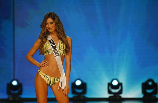 """<div class=""""meta image-caption""""><div class=""""origin-logo origin-image ap""""><span>AP</span></div><span class=""""caption-text"""">Miss Universe contestant Johanna Acs of Germany poses in her swimsuit during the preliminary competition in the Miss Universe beauty pageant. (AP Photo/Bullit Marquez) (AP)</span></div>"""