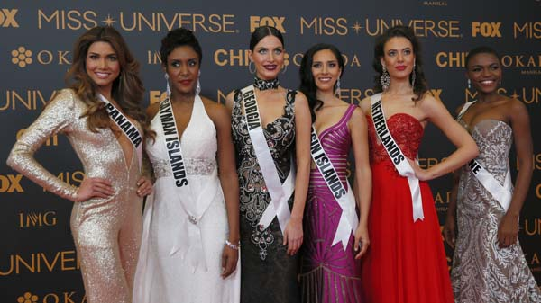 """<div class=""""meta image-caption""""><div class=""""origin-logo origin-image ap""""><span>AP</span></div><span class=""""caption-text"""">Miss Universe contestants pose on the red carpet on the eve of their coronation Sunday. (AP Photo/Bullit Marquez) (AP)</span></div>"""