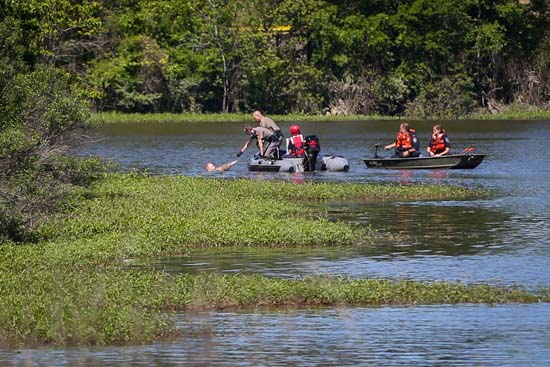 <div class='meta'><div class='origin-logo' data-origin='KTRK'></div><span class='caption-text' data-credit='Michael Minasi, The Courier'>A car chase suspect was rescued from a gator-filled lake in Montgomery County Monday morning.</span></div>