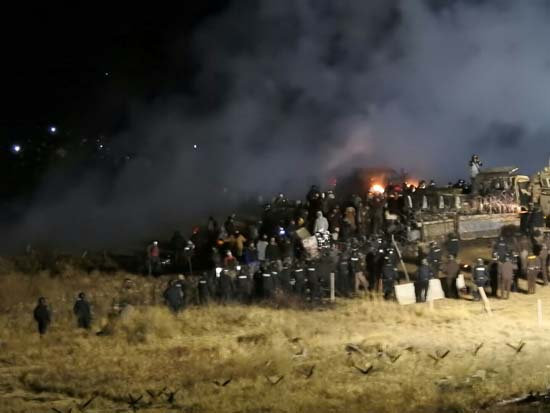 <div class='meta'><div class='origin-logo' data-origin='none'></div><span class='caption-text' data-credit='(Morton County Sheriff????????s Department via AP)'>Law enforcement and protesters clash near the site of the Dakota Access pipeline on Sunday, Nov. 20, 2016, in Cannon Ball, N.D.</span></div>