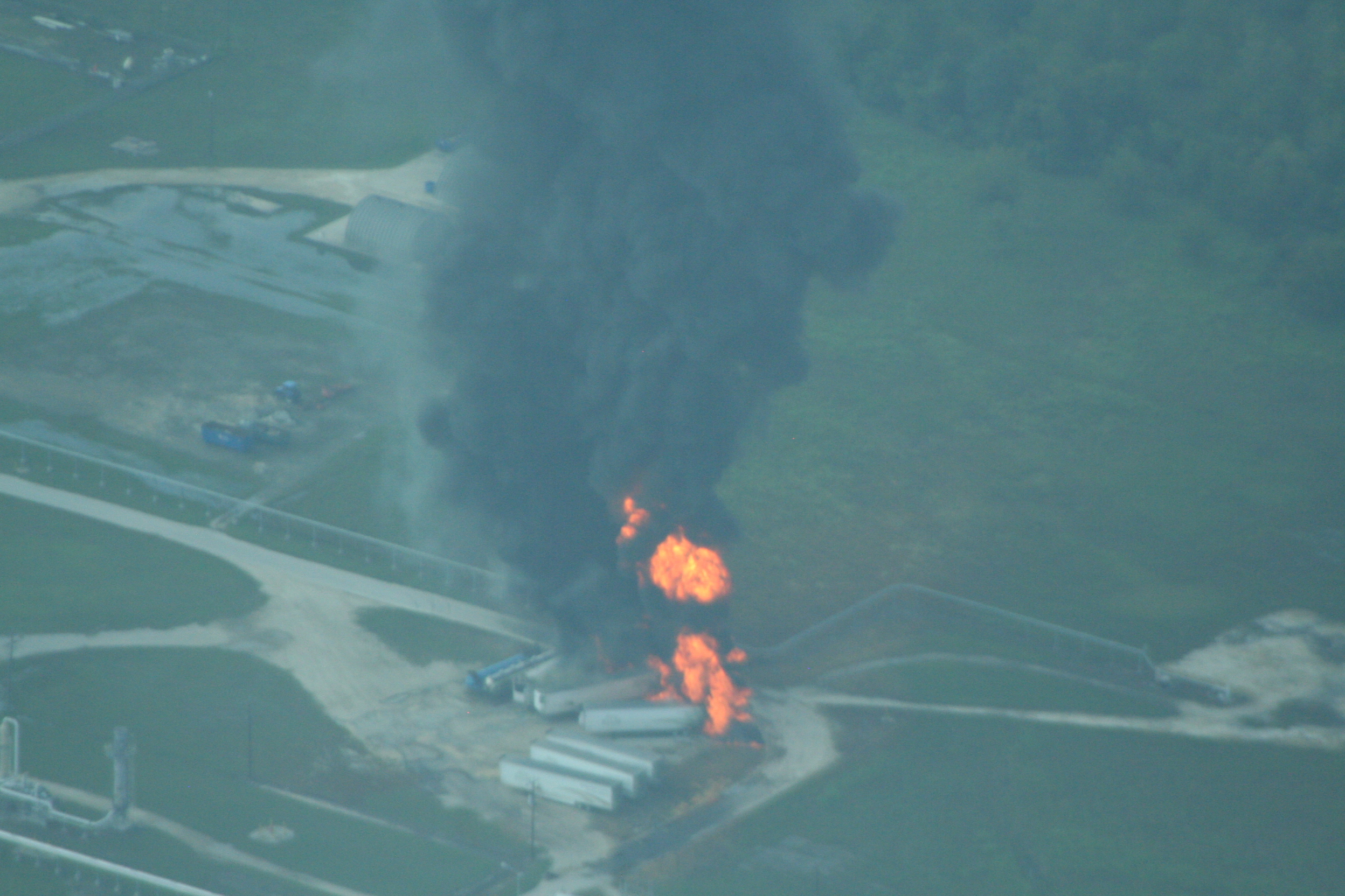<div class='meta'><div class='origin-logo' data-origin='none'></div><span class='caption-text' data-credit='EPA photo'>Photos from EPA show immediate explosions at Arkema from an aircraft flying inside the evacuation zone.</span></div>
